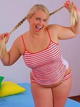 Joyful blonde plump schoolgirl eats and rides meaty cock