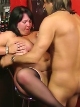 Hot brunette BBW hottie in black stockings boned on a bar counter by a horny patron