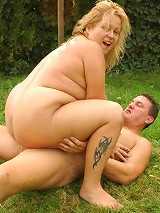 Horny blonde BBW Helga giving off a blowjob and taking deep cock dipping in this live outdoor sex