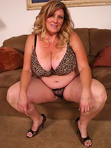 Plump momma Deedra struts her hot and curvy body and gets a stud to cram her face hole with cock