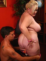 A pretty blonde plumper named Bunny working a huge erect cock with her mouth and fat pussy